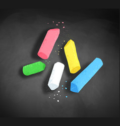 Pieces of chalk on blackboard background vector