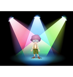 A boy wearing an eyeglass standing on the stage vector