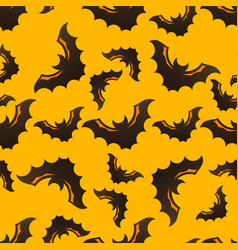 Halloween seamless pattern with bats vector