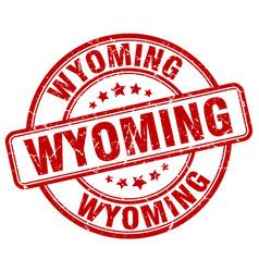 Wyoming red grunge round vintage rubber stamp vector