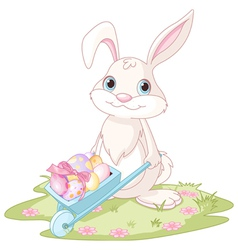 Easter Bunny with wheelbarrow vector image vector image