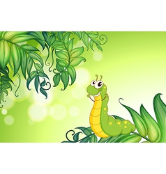 A worm crawling at the leaves vector