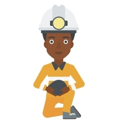 Miner holding coal in hands vector