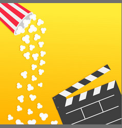 Popcorn falling from round box open clapper board vector