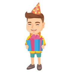 caucasian boy in birthday cap holding gift box vector image