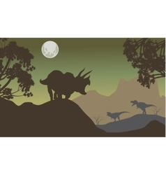Silhouette of triceratops and baby T-Rex vector image