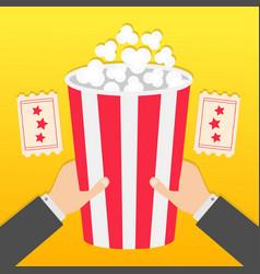 Two human businessman hands holding big popcorn vector