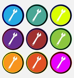 Wrench icon sign nine multi colored round buttons vector
