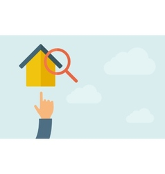 Hand pointing to house with magnifying glass vector