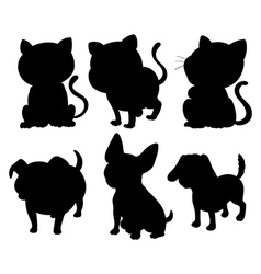 Silhouettes of cats and dogs vector