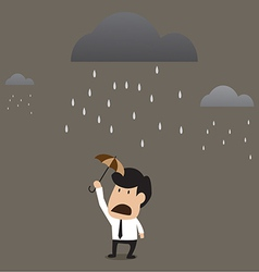 Businessman under a little umbrella in the rain vector