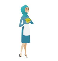 Young muslim cleaner holding money vector