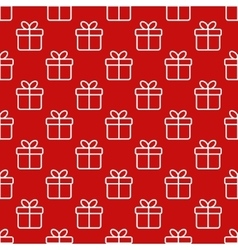 Seamless red pattern with gift boxes vector
