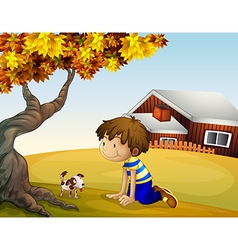 A boy and his puppy under the tree vector image