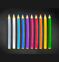 Color pencils lying on black chalkboard vector