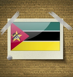 Flags mozambique at frame on a brick background vector