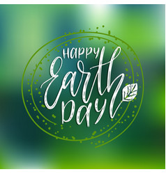 Happy earth day hand lettering on blurred vector