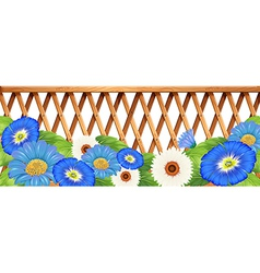 A fence with blue and white flowers vector image vector image