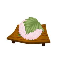 Sakuramochi or japanese rice cake on geta plate vector