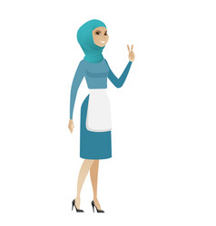 Young muslim cleaner showing victory gesture vector