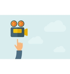 Hand pointing to a video cam icon vector