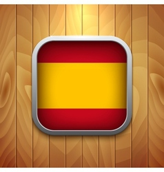 Rounded square spain flag icon on wood texture vector