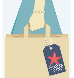 Paper bag tagged with a starfish symbol of summer vector image vector image