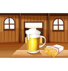 A mug of cold beer and french fries at the saloon vector