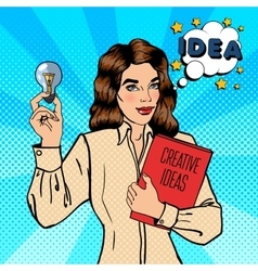 Business woman holds a light bulb pop art vector