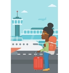 Woman at the airport with suitcase vector