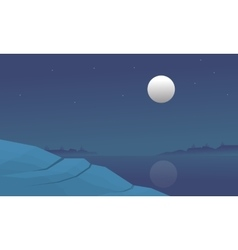 Silhouette of lake and hill at night vector