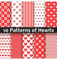 Heart shape seamless patterns red color vector