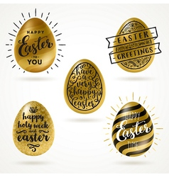 Set of golden eggs with Easter greeting type vector image