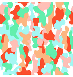 Camouflage seamless pattern in a pink orange vector