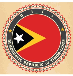 Vintage label cards of east timor flag vector