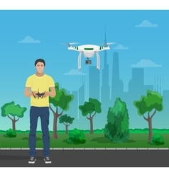 Guy controling aerial quadrocopter drone in the vector