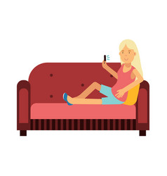 Young woman sitting on a sofa using her smartphone vector