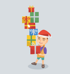 caucasian boy holding christmas gift boxes vector image