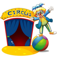 A clown at the top of the ball beside a circus vector image vector image