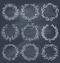 Set of winter wreaths on blackboard vector