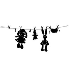 Silhouette toys drying on rope after washing vector