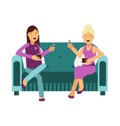 Two women sitting on a sofa talking and eating a vector