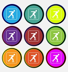 Ice skating icon sign Nine multi colored round vector image vector image