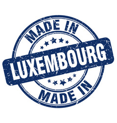 Made in luxembourg blue grunge round stamp vector