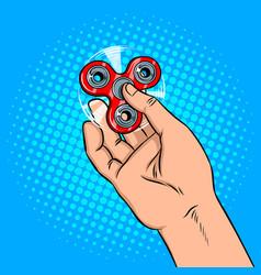 spinner in hand pop art vector image vector image