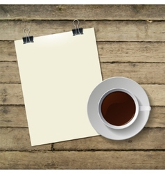 cup of hot coffee and note paper on wood vector image