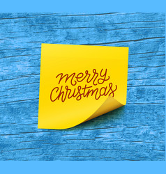 Merry christmas text on yellow sticky note paper vector