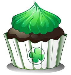 A cupcake with a green icing vector image vector image