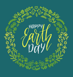 Happy earth day hand lettering in round floral vector
