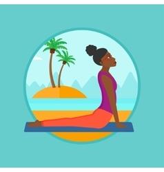 Woman practicing yoga upward dog pose on beach vector